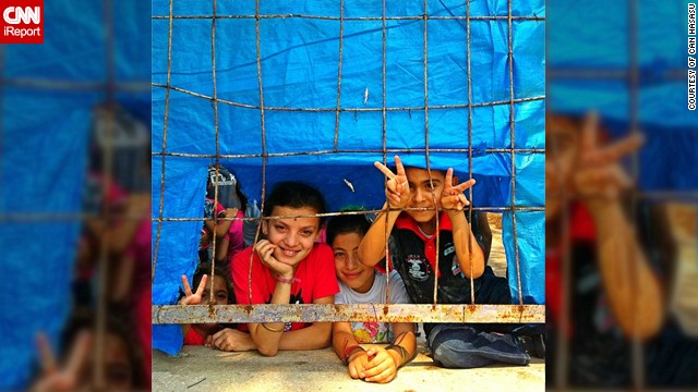 "This photo of <a href='http://statigr.am/viewer.php#/user/42266969/' target='_blank'>Syrian refugee children</a> was taken last year at the Hatay's Yayladağı refugee camp in Turkey by TV journalist Can Hasasu. ""Eid, or Bayram as we call it in Turkey, is like Christmas for children, a cheerful feast. They collect money and gifts. Families buy new clothes for them. It was sad to see these children behind the fences of the camp. No money, no new clothes, no gifts and for some no family anymore. Despite all the sufferings in their country these children were smiling,"" said the 36-year-old from Istanbul."