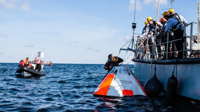 The Copenhagen Suborbitals team pulls Beautiful Betty from the sea. The capsule is two meters in diameter, and is built to house just one passenger lying horizontally.