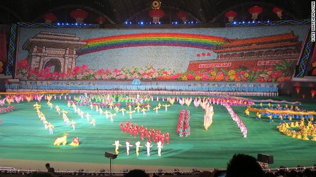 That rainbow-themed backdrop consists of thousands of people holding up different boards. This year they flashed messages of peace and friendship, as well as the rainbow between Pyongyang's Arch of Triumph and Beijing's Tiananmen Square Gate, while Lion Dancers, Pandas and Russian Dancers strutted about on stage.