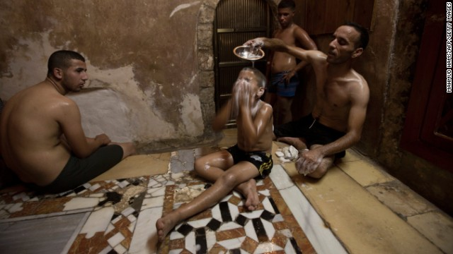 People relax inside the Hamam al-Sammara Public Baths during preparations for the Eid Al-Fitr feast in Gaza City on August 7.