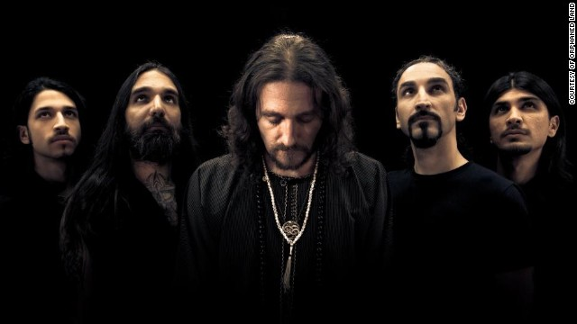 Orphaned Land is a Jewish group. Farhi, center, says he knows music might not solve the Arab-Israeli conflict, but he hopes to provide inspiration.