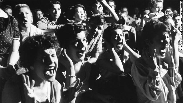 Screaming teenage girls watching Elvis in concert.