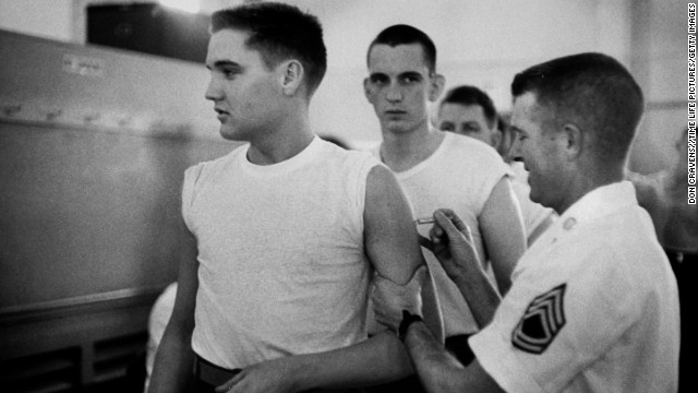 U.S. Army Pvt. Elvis Presley gets a shot from at his pre-induction physical at Kennedy Veterans Hospital on March 26, 1958.