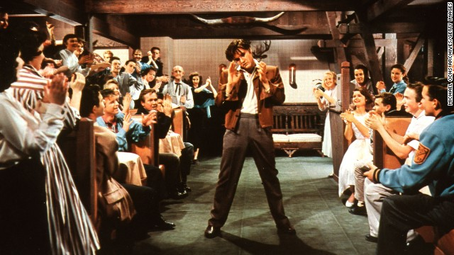 """Elvis performs in the 1957 movie """"Loving You."""" He starred in 31 feature films and two performance documentaries in his lifetime."""