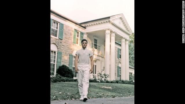 Elvis walks the grounds of Graceland in 1957.