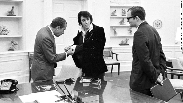 Elvis shows President Richard Nixon his cuff links at the White House, on December 21, 1970.