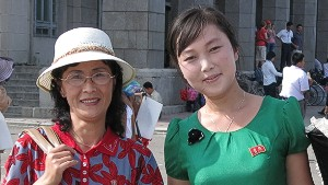 Two North Koreans display their \
