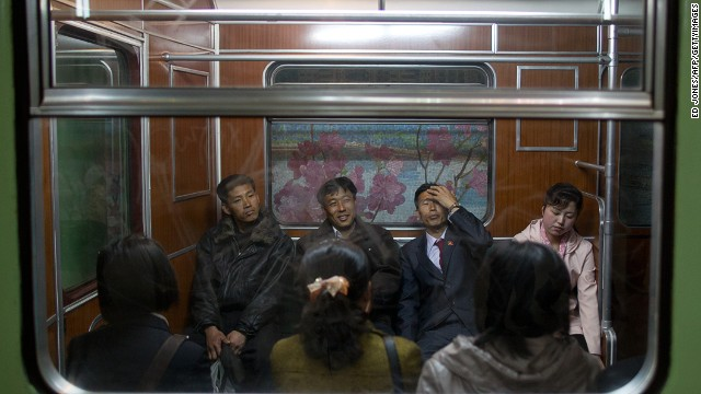 Commuters sit aboard a train at Puhung subway station in Pyongyang. The underground network has two lines and 17 stations. Inspired by the grand Moscow Metro, many of the stations have ornate chandeliers and paintings and murals on the walls.
