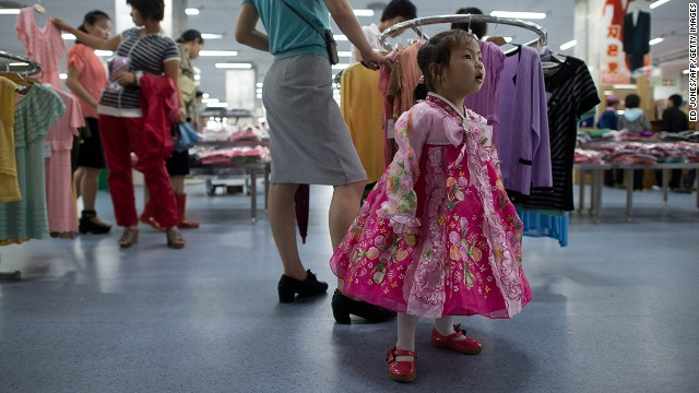 A North Korean girl wearing traditional dress stands at a clothing section inside a supermarket in Pyongyang. Officially, visitors aren't allowed in department stores, but this is a rule that is given flexibility.