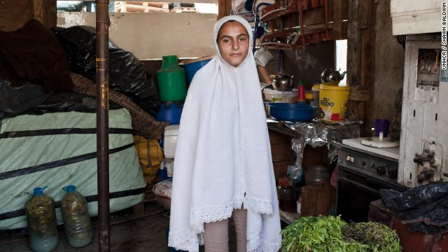 Syrian refugee, Mona, 14, lives with her parents and five younger siblings in Beirut, Lebanon. Mona says that her family decided to flee Syria the day their neighbor was killed in front of their house. She and her extended family of over 40 people now live in two makeshift buildings in Beirut. The food they ate for iftar comes mostly from charity.