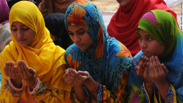 Women pray at a Lahore, Pakistan, mosque during the first day of the Eid al-Fitr holiday on Friday, August 9. Muslims around the world are celebrating Eid al-Fitr, marking the end of the fasting month of Ramadan.