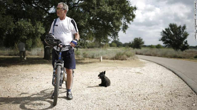 President George W. Bush rides a bicycle at his ranch in Crawford, Texas, in August 2007.