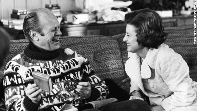 President Gerald Ford opens a gift from his wife, Betty Ford, during their usual Christmas holiday vacation spot in Vail, Colorado, December 1974.