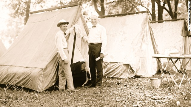 President Warren Harding, right, goes camping with Firestone Tire Co. founder Harvey Firestone in 1921.