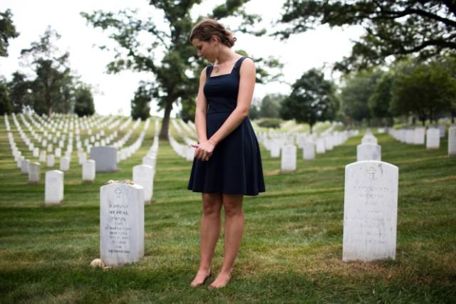 Alison Spann visits her father's grave at Arlington.