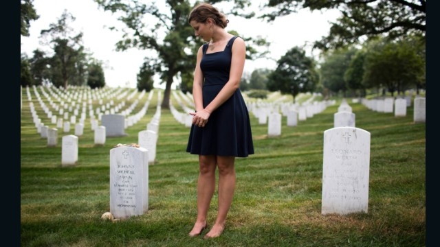 Alison Spann visits her father's grave at Arlington. (EVELIO CONTRERAS/CNN)