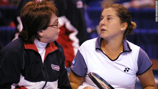 King, in her role as captain of the United States Fed Cup team, gives a pep talk to Monica Seles during a 2000 tie against Belgium.