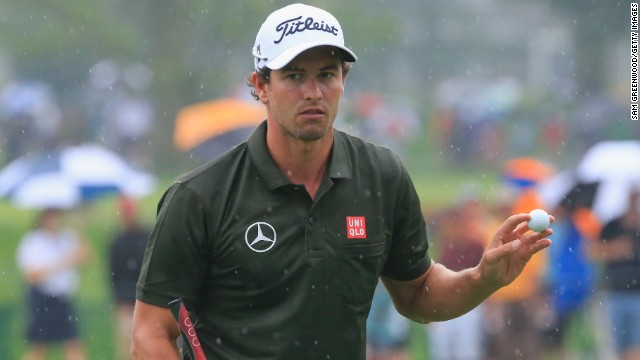 Adam Scott acknowledges the galleries on his way to a second round 68 at a rainy Oak Hill in the second round of the PGA Championship.