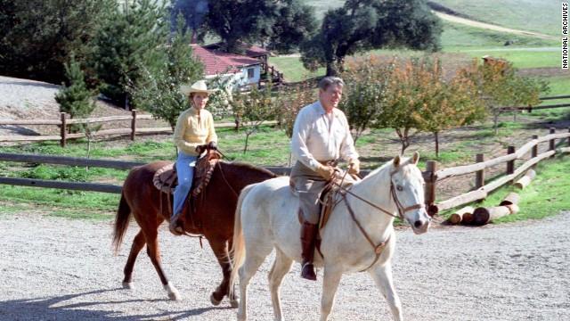 President Ronald Reagan and first lady Nancy Reagan ride horses at their vacation home in Santa Barbara, California, in November 1982.