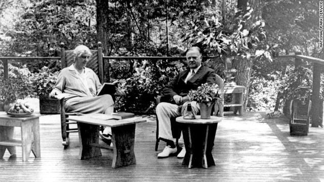 President Herbert Hoover and Lou Henry Hoover sit on the porch of their Radipan Camp retreat, now part of the Shenandoah National Park, in Virginia. The president originally bought the land for the vacation spot in 1929.