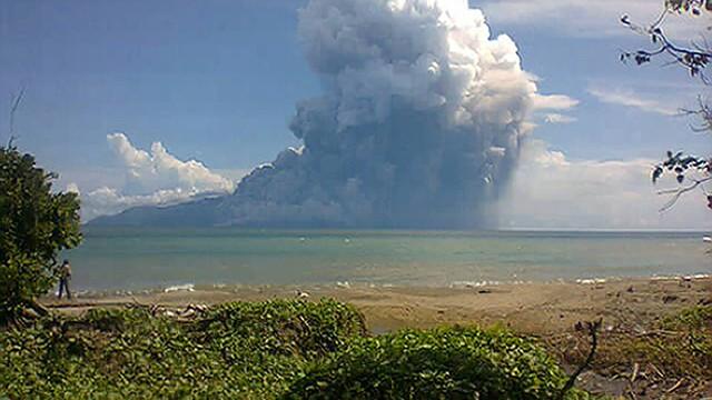 The Mount Rokatenda volcano spews a huge column of hot ash during an eruption on August 10, 2013.
