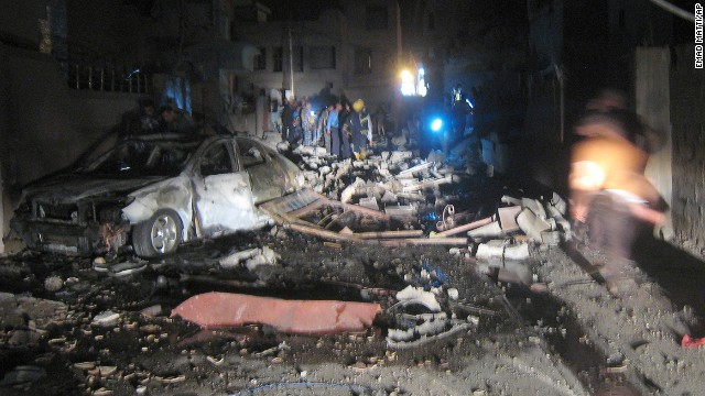 First responders inspect the scene of a car bomb attack near a mosque in Kirkuk on August 10.