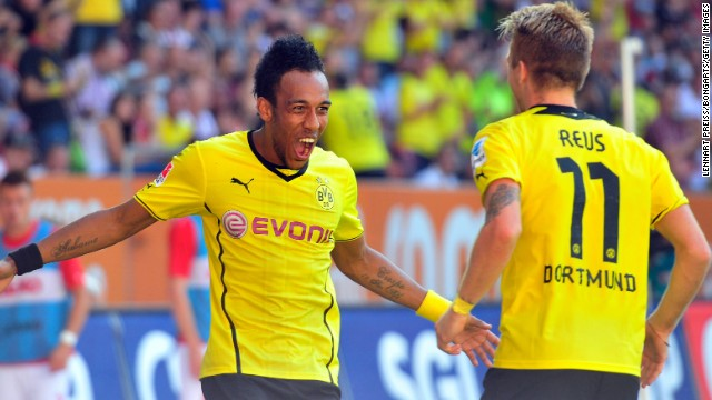 Pierre-Emerick Aubameyang celebrates with Marco Reus after scoring the second of his three goals against Augsburg.