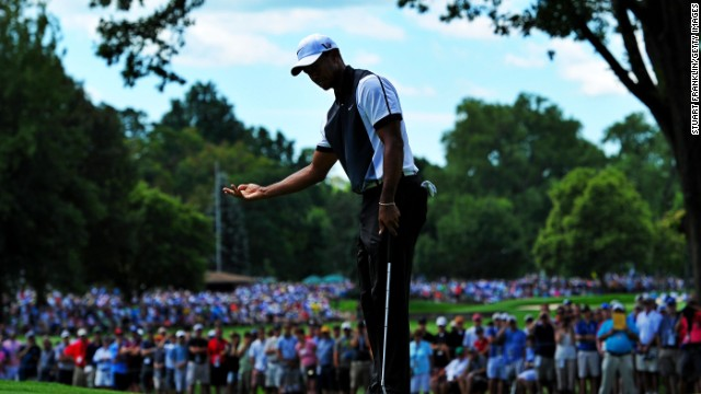 Tiger Woods reacts after missing a shot at the fourth hole. Woods won the last of his 14 majors in 2008 and the drought is set to continue after his struggles in the third round.