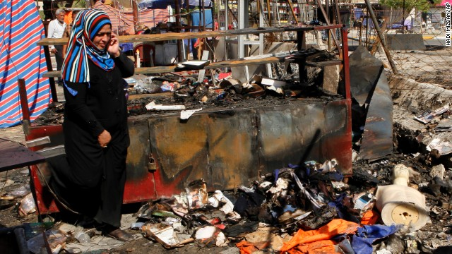 A woman inspects the aftermath of a car bomb attack on a store in Baghdad on Sunday, August 11. <a href='http://www.cnn.com/2013/08/10/world/meast/iraq-violence/index.html'>Bloodshed erupted Saturday throughout Iraq</a> as dozens were killed and more than 190 wounded in a wave of bombings amid Eid festivities, which mark the end of the holy month of Ramadan.