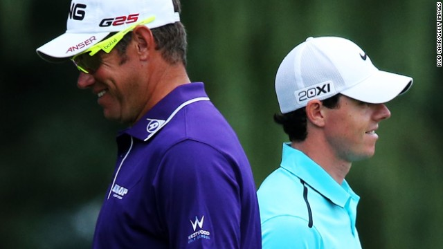 Ryder Cup teammates Lee Westwood, left, and Rory McIlroy had time to see the lighter side. After his tough final round at the British Open, Westwood again struggled in the final round at Oak Hill.