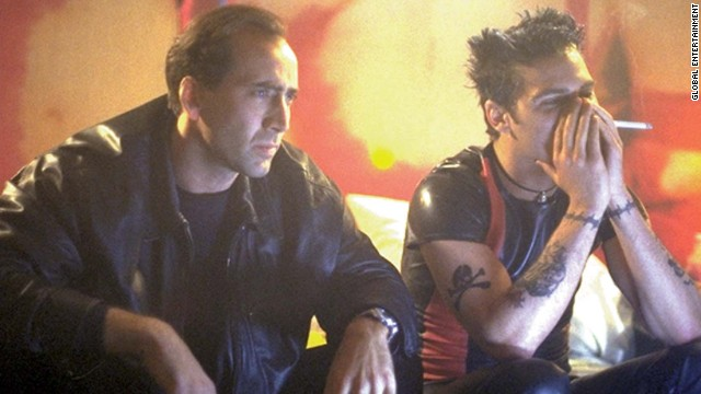 "Nicolas Cage stars as a private investigator who has to delve into the world of porn to solve a case in ""8mm.'"" The 1999 film co-stars Joaquin Phoenix."
