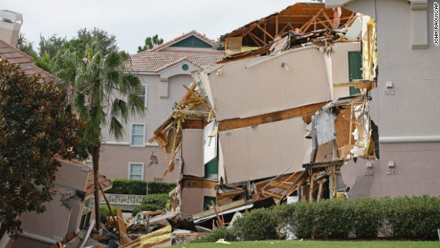 A 60-foot-wide sinkhole formed under a resort in central Florida late on Sunday, August 11, forcing guests out of their rooms as one three-story building collapsed and another slowly sank.