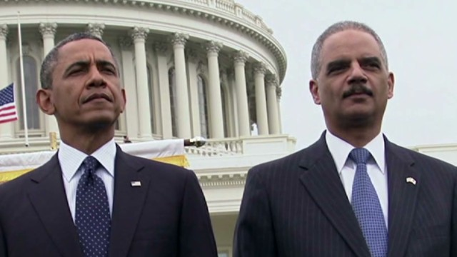 Sources say that Attorney General Eric Holder is staying on at the behest of President Barack Obama.