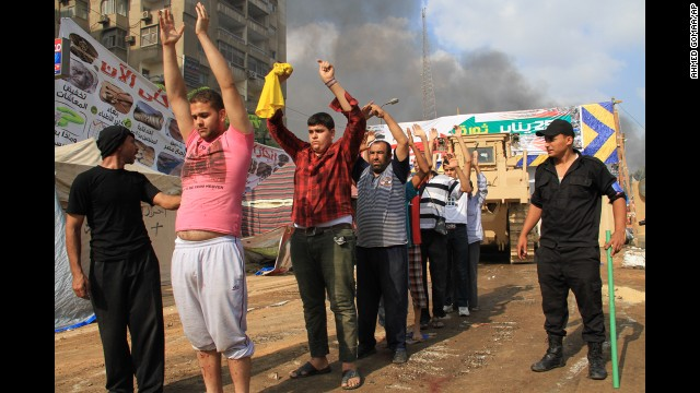 Egyptian security forces detain protesters in Cairo's Nasr City district on August 14.