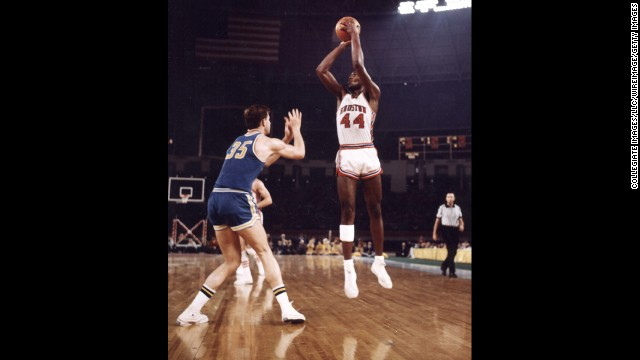 "Elvin Hayes of the University of Houston Cougars goes for a jump shot against the UCLA Bruins in what became known as ""The Game of the Century."" The January 20, 1968, event was the first regular-season NCAA game broadcast in prime time on national television and also the first basketball game at the Astrodome."