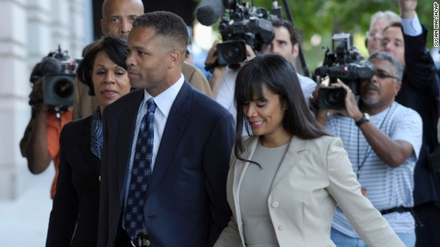 Former U.S. Rep. Jesse Jackson Jr., D-Illinois, and his wife, Sandra, arrive at federal court in Washington on August 14, 2013, for sentencing. Jackson was sentenced to 30 months in prison for improper use of campaign funds, while his wife got 12 months for filing false tax returns.