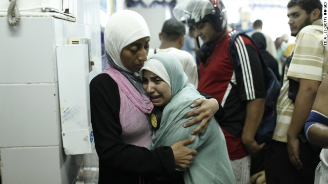 A Morsy supporter reacts after identifying the body of a dead family member at the Rabaa al-Adawiya Medical Center on August 14 in Cairo.