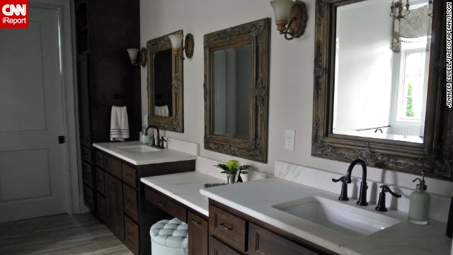 <a href='http://ireport.cnn.com/docs/DOC-1017236'>Jennifer Elwell's</a> master bathroom mixes <a href='http://www.talesofapeanut.com' target='_blank'>traditional and rustic</a> decor.