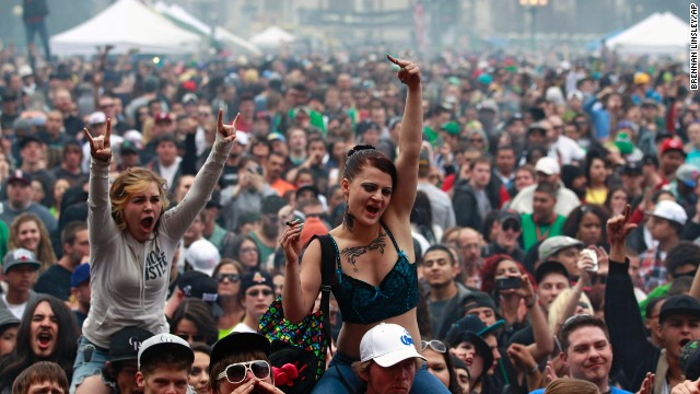 Members of a crowd numbering tens of thousands smoke and listen to live music at the Denver 420 Rally on April 20. <a href='http://www.cnn.com/2013/04/20/opinion/reiman-marijuana-day/index.html'>Annual festivals celebrating marijuana</a> are held around the world on April 20, a counterculture holiday.