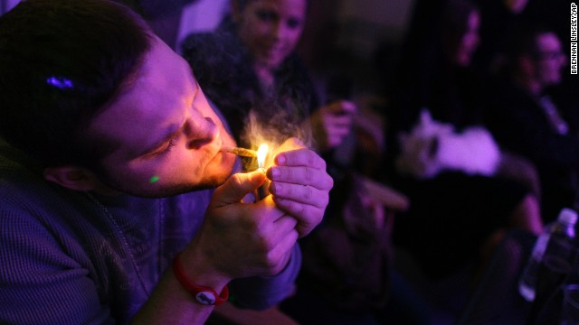 "A man smokes a joint during the official opening night of Club 64, a marijuana social club in Denver, on New Year's Eve 2012. Voters in <a href='http://www.cnn.com/2012/11/07/politics/marijuana-legalization/index.html'>Colorado and Washington state</a> passed referendums to legalize recreational marijuana on November 6, 2012."" border=""0″ height=""360″ id=""articleGalleryPhoto003″ style=""margin:0 auto;display:none"" width=""640″/><cite style="