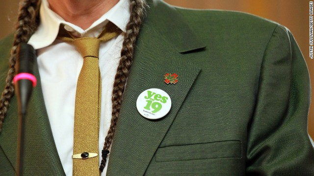 "Marijuana activist Steve DeAngelo wears a ""Yes on Prop 19"" button as he speaks during a news conference in Oakland, California,"