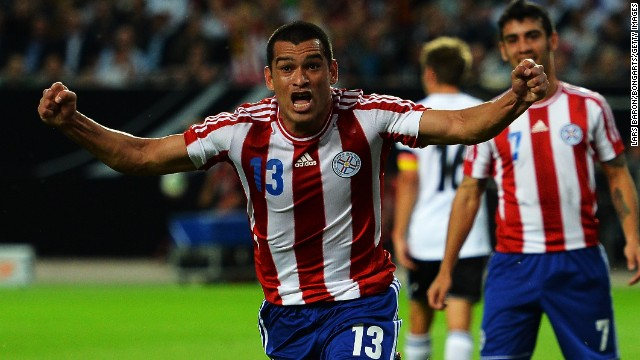 Miguel Samudio of Paraguay celebrates after scoring his team's third goal during the international friendly against Germany. The hosts hit back to tie the game 3-3.