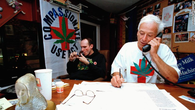 Dennis Peron takes notes during a phone interview while Gary Johnson lights up at the Proposition 215 headquarters in San Francisco on October 11, 1996. The ballot measure was approved when voters went to the polls in November, allowing medical marijuana in California.