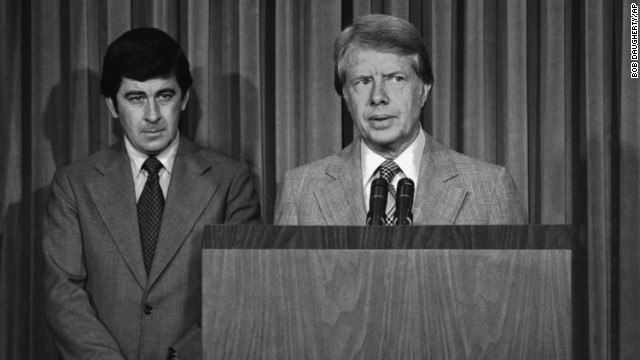 President Jimmy Carter, with his special assistant for health issues, Dr. Peter Bourne, beside him, talks to reporters at the White House about his drug abuse control message to Congress on August 2, 1977. Among other things, he called for the elimination of all federal criminal penalties for the possession of up to one ounce of marijuana.