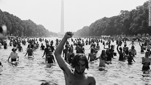 Protesters wade in the Reflecting Pool at the National Mall in Washington during the