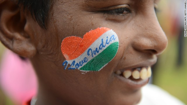 A pupil, cheek decorated with a patriotic message, participates in celebrations in Secunderabad, the twin city of Hyderabad.
