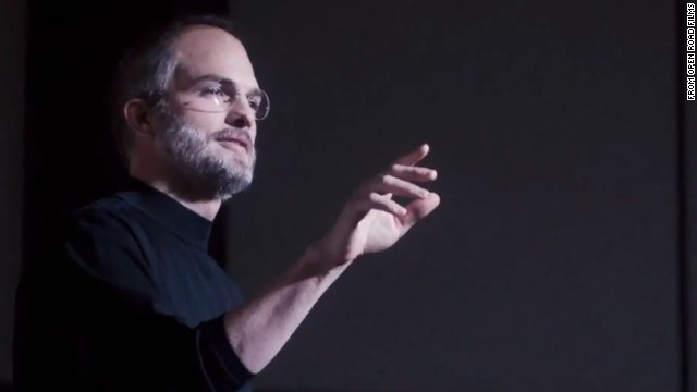 """The movie opens with Jobs, now wearing his trademark black turtleneck, introducing the original iPod to a gathering of Apple employees in 2001. """"It's a thousand songs in your pocket,"""" he says. Kutcher worked hard to mimic Jobs' speech patterns and distinctive gait."""