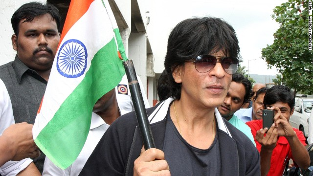 Indian Bollywood actor Shah Rukh Khan (center) poses with an Indian tricolour in Mumbai.
