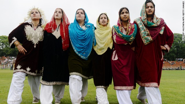 Kashmiri women dance during an event at The Bakshi Stadium in Srinagar.