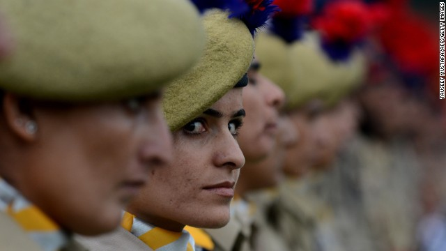 Jammu and Kashmir Armed Police (JKAP) servicewomen stand in formation at the Bakshi Stadium in Srinagar on August 15, 2013.